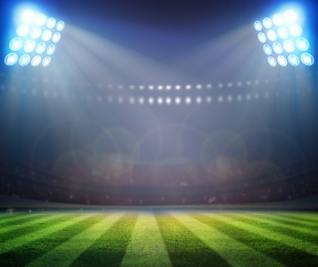 Groen voetbalveld, felle lampen,