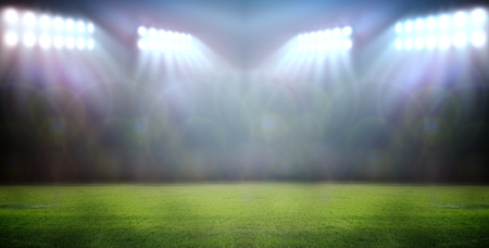 stadium lights at night in stadium photo