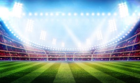 Stadion fotbal hra světla zářící na zelené trávě pole pro sportovní koncept.