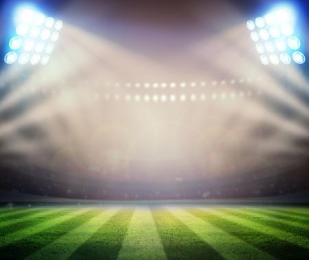 Green soccer field, bright spotlights, photo