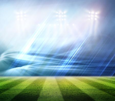 stadium lights: Stadium football game lights are shinning on a green grass field for a sport concept.