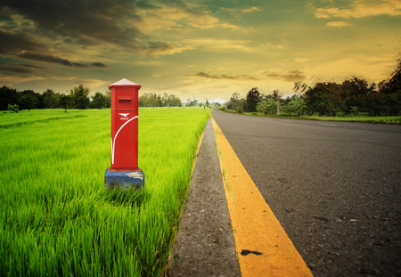 postbox on road side photo