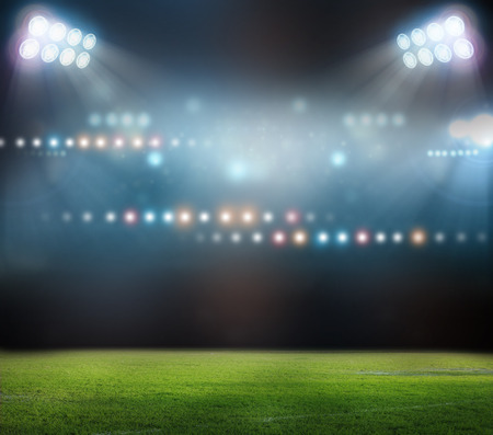 baseball game: Green soccer field, bright spotlights,