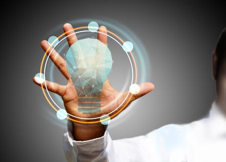 Light bulb in hand Standard-Bild - 37920244