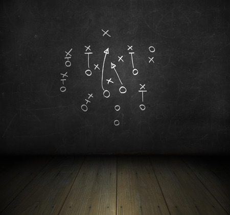score board: Football play strategy drawn out on a chalk board