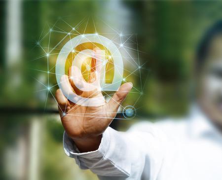sending: Businessman pressing online messaging mail icon sending Stock Photo
