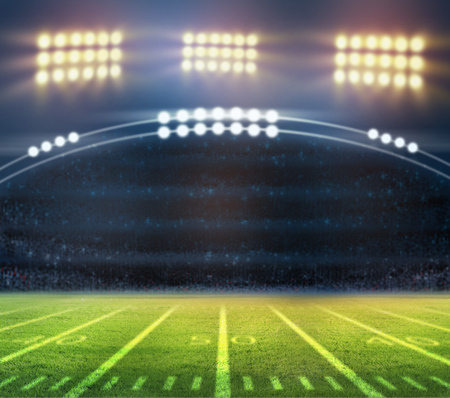 american football ball: lights at night and stadium blur