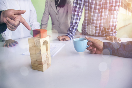 Planning, risk and strategy in business, business gambling placing wooden block