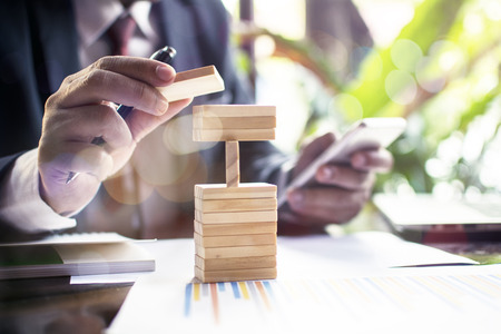 Planning  risk and strategy in business  business gambling placing wooden block Stock Photo
