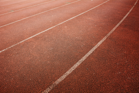 White lines and texture of running racetrack,