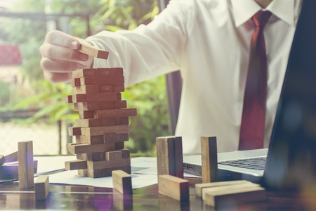 Businessman Building Up Tower  Challenge In Business Concept Фото со стока