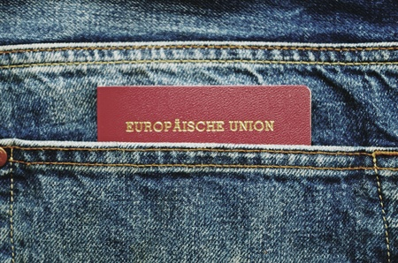 jeans pocket: European passport in jeans pocket
