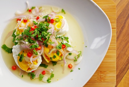 original plate: Eggs salad on white plate with sour and spicy, original thai style recipes.