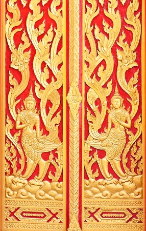 red and yellow thai painting in buddha temple building photo
