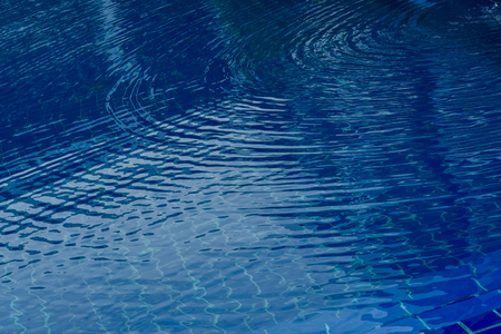 Water lisp in the swimming pool. Stock Photo