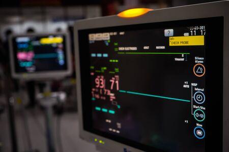 Modern vital sign monitor on patient background at ward in the hospital. Reklamní fotografie