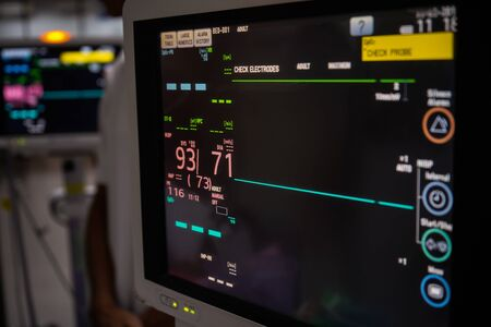 Modern vital sign monitor on patient background at ward in the hospital. Archivio Fotografico - 127826691