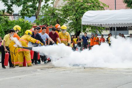 Thailand : July 30, 2019 : Peoples preparedness for fire drill and training to use a fire safety tank in the hospital. Udon Thani, Thailand.