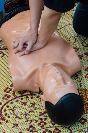 CPR training chest compressions for first aid  in emergency. Imagens
