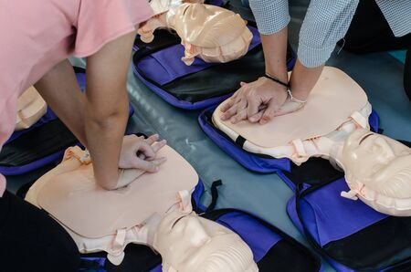 CPR training chest compressions for first aid  in emergency.