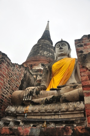 actuary: Statue buddha and Pagoda at Wat Yai Chaimongkol Temple Ayutthaya, Thailand  Stock Photo