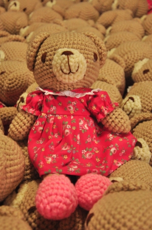 Cute teddy bear isolated on teddy background photo