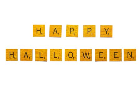 Halloween word on wooden texture isolated on white background