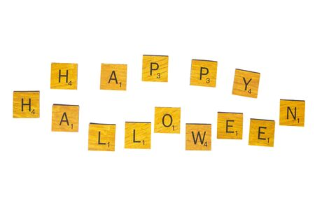 Happy Halloween word on wooden texture isolated on white background