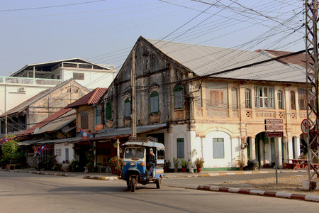 french ethnicity: Old building and TookTook taxi, Savannakhet, Lao PDR
