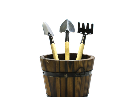 Gardening tools in wooden barrel on isolate background.