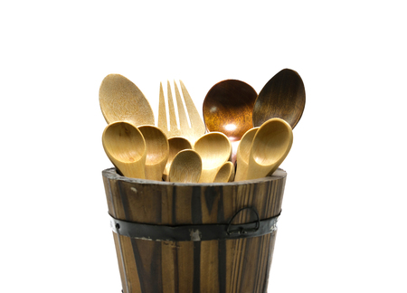Wooden spoon and fork in barrel on isolate background. Stock fotó