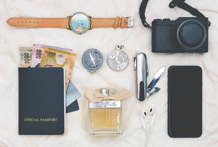 Top view, Accessories or travel plan with passport, wallet, watch, compass, camera and perfume. Stock fotó