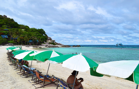 The beach chair and umbrella on the beach with blue sea at Koh Chang island in Thailand Stock fotó