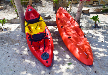 Two red color of Kayak on the beach stand by for Adventu