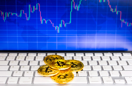 Gold bitcoin and trading chart background. Virtual currency concept.