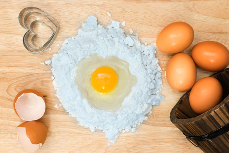 Top view composition flour with egg and ingredients for homemade bakery on wooden background Stock fotó