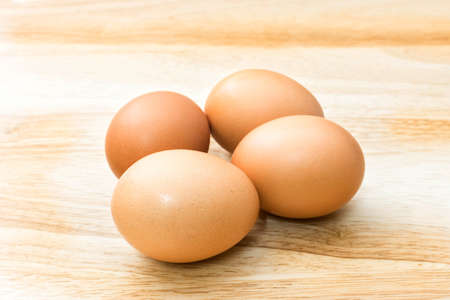 fresh eggs on wooden background