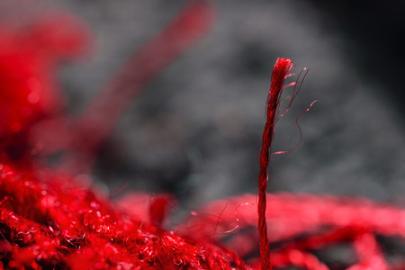 microfiber: Extreme Close-Up Of One Vibrant Red Fiber Woven In Spiral