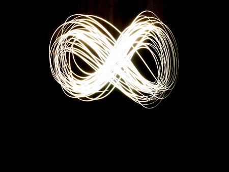 Abstract Long Exposure Of The Infinity Symbol During Night Stock