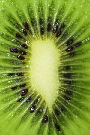 Extreme Close-Up Of Fresh Green Kiwi Fruit Slice Stock Photo
