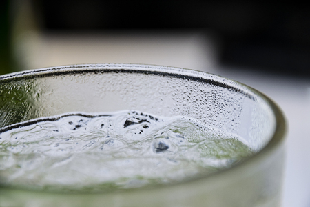 Close-Up Of Fresh Mojito In Glass With Ice Cubes