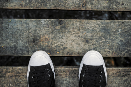 textile image: High Angle View Of Shoes On Rustic Wooden Bridge