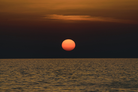 Scenic View Of Sunset Over Calm Ionian Sea Against Sky
