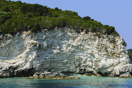 greece granite: Scenic View Of Intricate Cliff Near Ionian Sea Against Clear Blue Sky