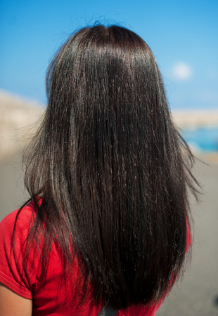 view of a young woman with long dark brown straight hair on the scenery. Sumer look Stock Photo