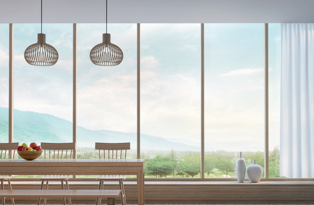Modern dining room with mountain view 3d rendering Image.Decorate room with wood. There are large window overlooking the surrounding nature and mountains Imagens