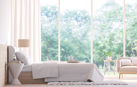 Modern bedroom  3d rendering image.There wooden floor white bed and  large window overlooking to nature and forest Archivio Fotografico