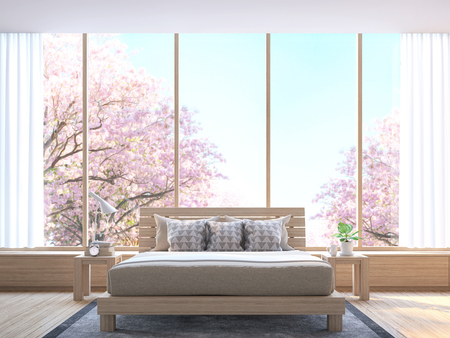 Modern bedroom decorate room with wood  3d rendering image.There wooden floor and  large window Look out to see the tree with pink flowers.