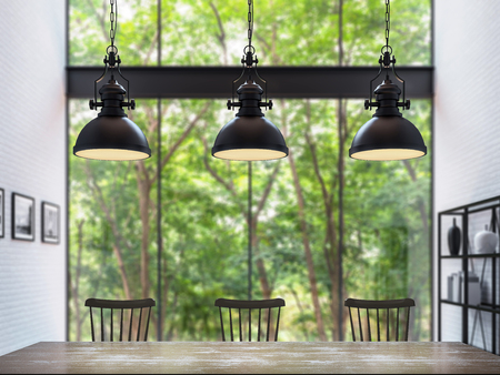 Modern loft dining room with blurry background 3d rendering image.Focus at the table Furnished with wood furniture has white brick walls and large windows look out to nature.