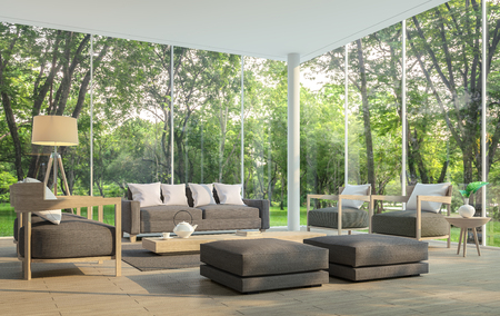 Modern living room with garden view 3d rendering Image.There are large window overlooking the surrounding garden and nature and finished with dark brown furniture Foto de archivo